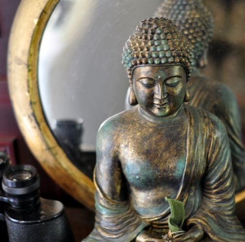 Buddah and mirror